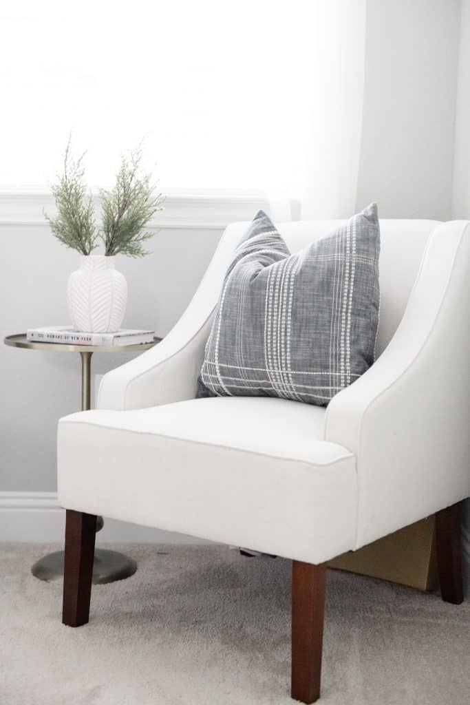 white chair with grey and white striped pillow