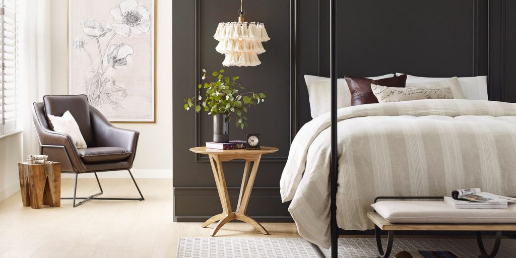 SW Urbane Bronze accent wall with canopy bed and wood side table