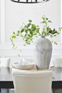Vase with leaves on dining table