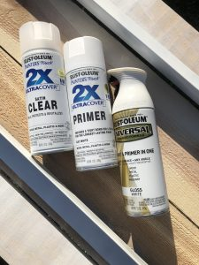 Bottles of spray paint and primer