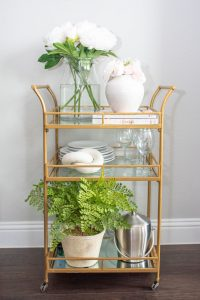 Kitchen cart with greenery and plates
