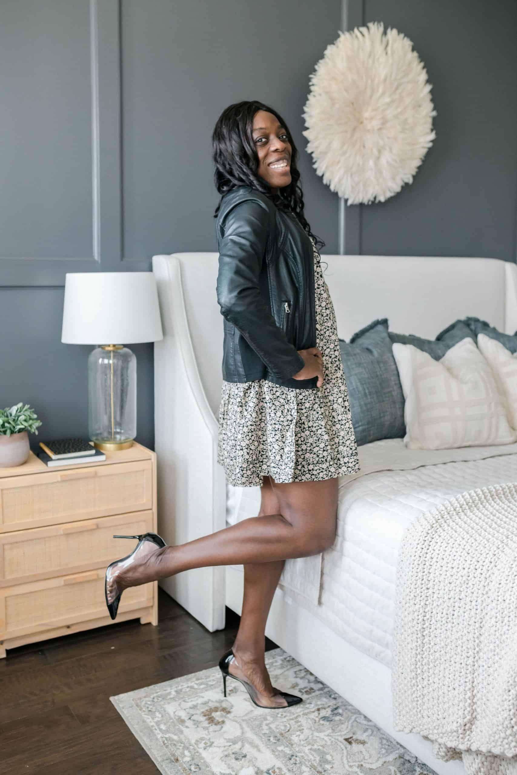 Modeling dress with heels in bedroom