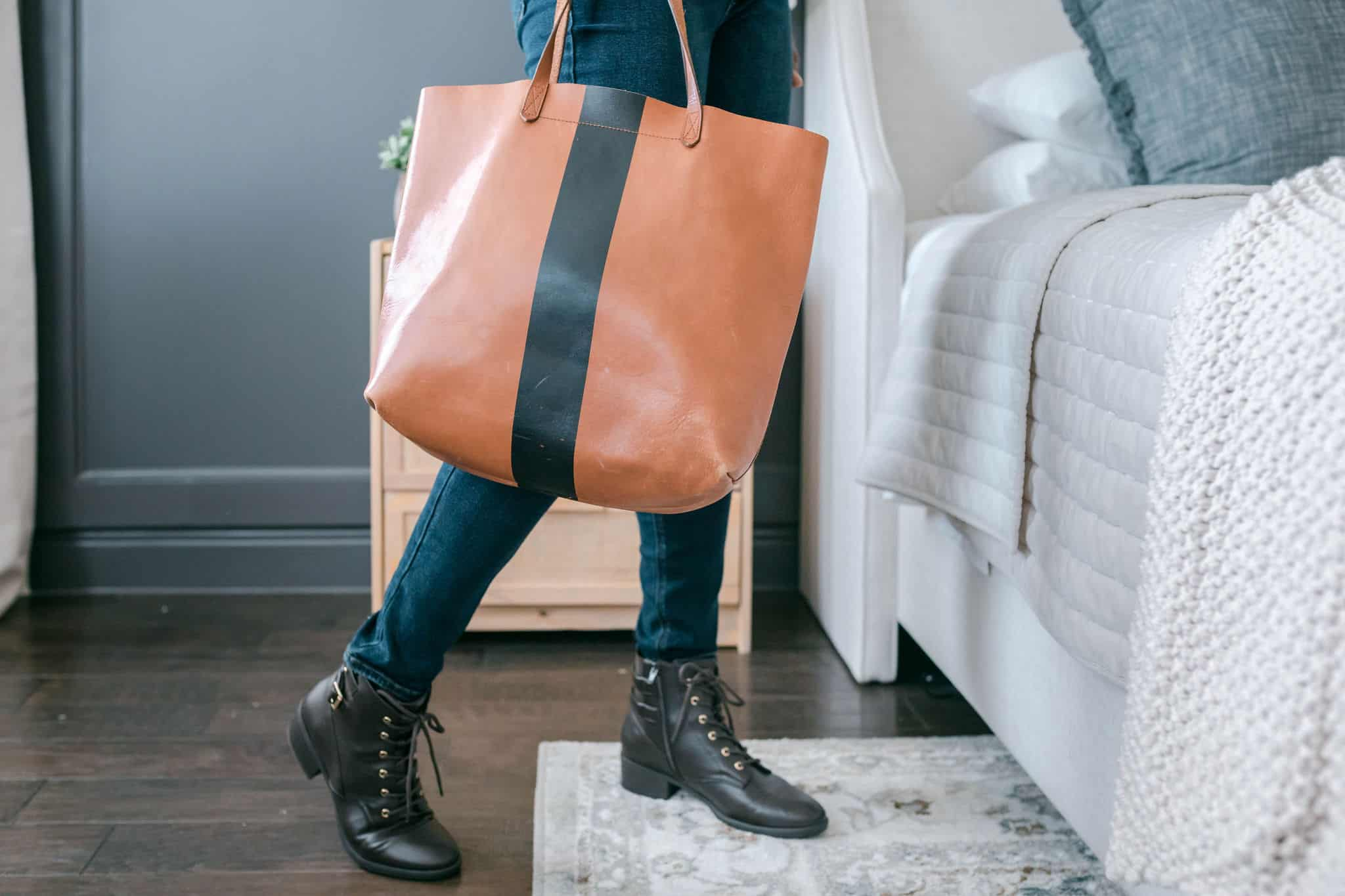 Modeling with a tote bag in bedroom with ankle boots