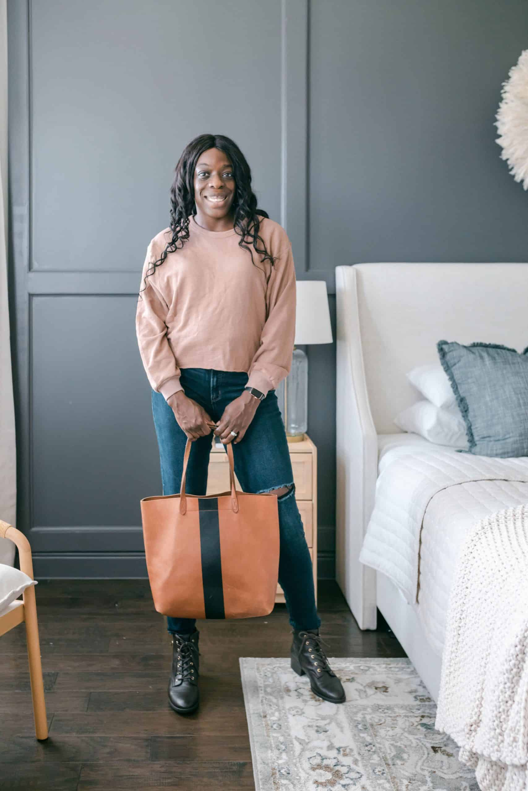 Modeling with a tote bag in bedroom