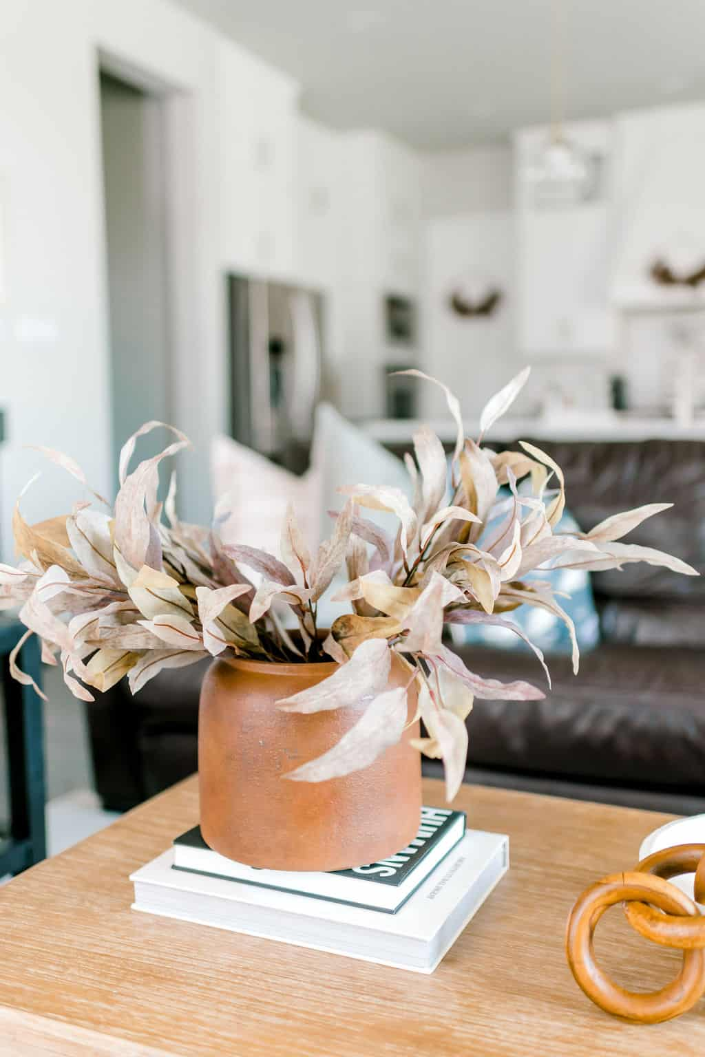 Stems in vase on table