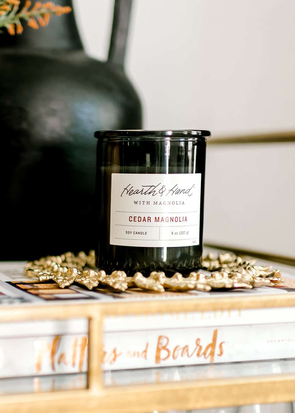 Cedar scented candle on table